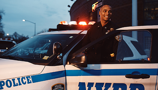 A New York Police Department getting into his squad car